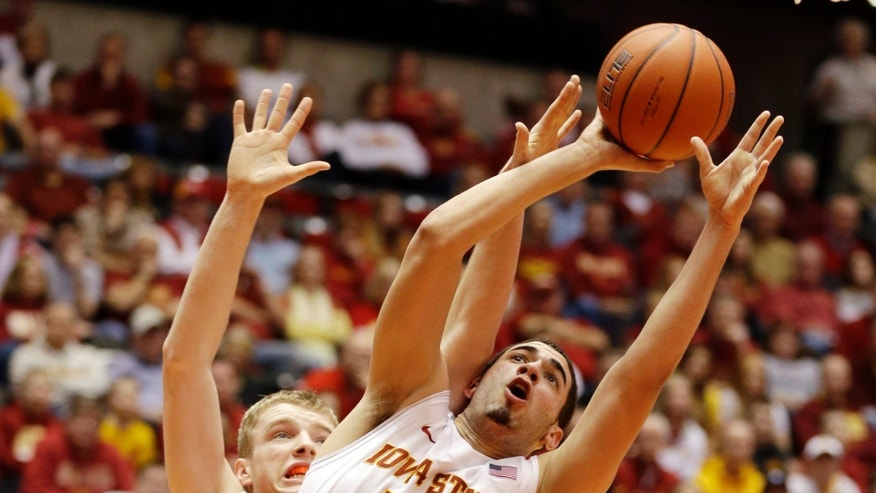 Iowa State forward Georges Niang (31) drives to the basket past Texas forward Connor Lammert, left, during the first half of an NCAA college basketball game, Saturday, Jan. 12, 2013, in Ames, Iowa. (AP Photo/Charlie Neibergall)