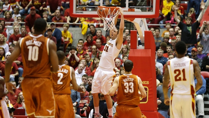 Iowa State forward Georges Niang (31) dunks the ball during the second half of an NCAA college basketball game against Texas, Saturday, Jan. 12, 2013, in Ames, Iowa. Niang scored 18 points as Iowa State won 82-62. (AP Photo/Charlie Neibergall)