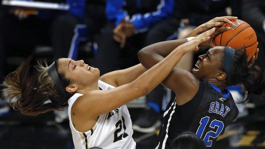 Duke's Chelsea Gray (12) is fouled by Wake Forest's Sandra Garcia (21) during the second half of an NCAA college basketball game in Winston-Salem, N.C., Sunday, Jan. 13, 2013. Duke won 73-44. (AP Photo/Chuck Burton)