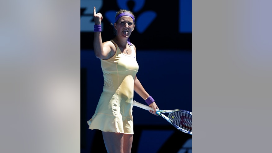 Victoria Azarenka of Belarus celebrates after defeating Romania's Monica Niculescu in their first round match at the Australian Open tennis championship in Melbourne, Australia, Tuesday, Jan. 15, 2013. (AP Photo/Andy Wong)