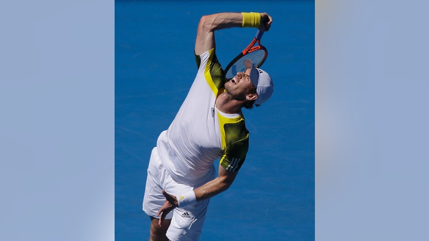 Britain's Andy Murray serves to Robin Haase of the Netherland's during their first round match at the Australian Open tennis championship in Melbourne, Australia, Tuesday, Jan. 15, 2013.  (AP Photo/Mark Baker)
