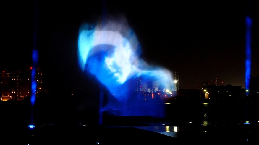 The image of golf world number one Rory McIlroy is projected on water, after he has been unveiled as a new Brand Ambassador for Nike during a press conference in Abu Dhabi, United Arab Emirates, Monday, Jan. 14, 2013. (AP Photo/Manuel Salazar)