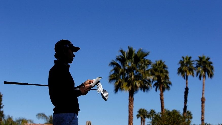 Camilo Villegas, of Colombia, looks down the 18th fairway during a practice round for the Humana Challenge golf tournament on the Palmer Private course at PGA West in La Quinta, Calif., Wednesday, Jan. 16, 2013. (AP Photo/Chris Carlson)