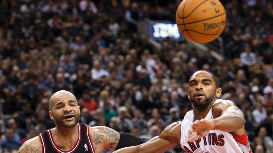 Toronto Raptors forward Alan Anderson (6) battles for a loose ball against Chicago Bulls forward Carlos Boozer, left, during the first half of their NBA basketball game, Wednesday, Jan. 16, 2013, in Toronto. (AP Photo/The Canadian Press, Nathan Denette)