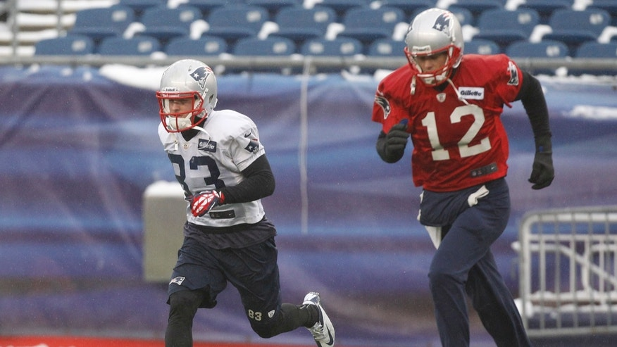 New England Patriots wide receiver Wes Welker (83) and quarterback Tom Brady run during practice at the NFL football team's facility in Foxborough, Mass., Wednesday, Jan. 16, 2013. The Patriots will play the Baltimore Ravens in the AFC Championship game for the second year in a row at Foxborough this Sunday. (AP Photo/Stephan Savoia)