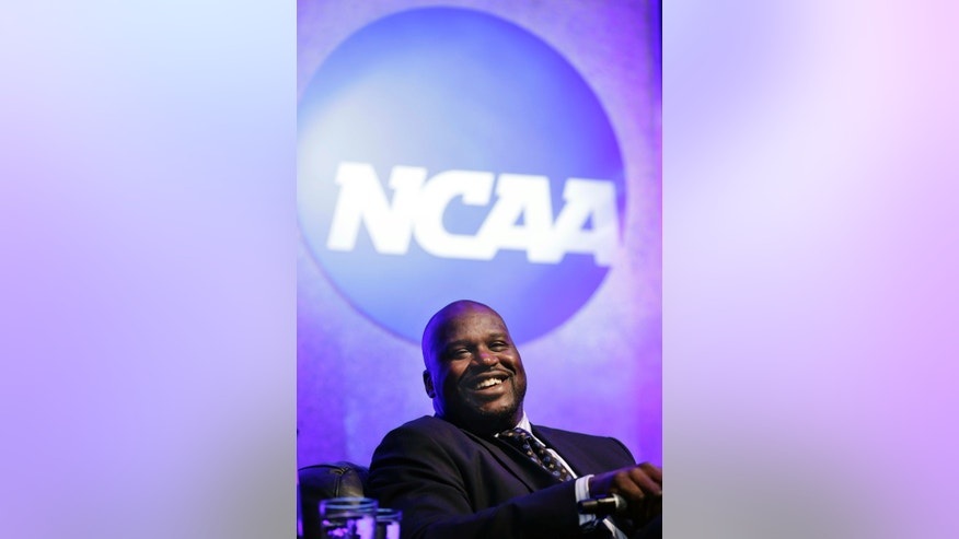 Former NBA great Shaquille O'Neal speaks at the NCAA's convention keynote luncheon Wednesday, Jan. 16, 2013 in Grapevine, Texas. O'Neal spoke about the importance of education in his life and the value his three degrees bring in his post-NBA basketball career. (AP Photo/LM Otero)