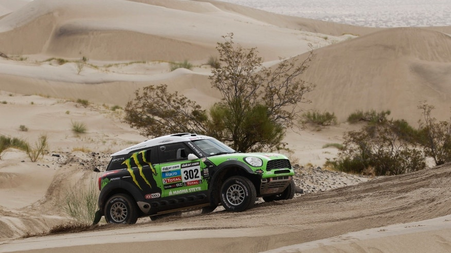 Stephane Peterhansel and Jean Paul Cottret, both of France, drive across the dunes during the 11th stage of the 2013 Dakar Rally from La Rioja to Fiambala, Argentina, Wednesday, Jan. 16, 2013. The race finishes in Santiago, Chile, on Jan. 20. (AP Photo/Victor R. Caivano)