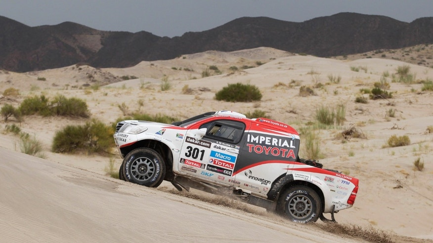 Giniel de Villiers of South Africa and Dirk Von Zitzewitz of Germany race their Toyota across the dunes during the 11th stage of the 2013 Dakar Rally from La Rioja to Fiambala, Argentina, Wednesday, Jan. 16, 2013. The race finishes in Santiago, Chile, on Jan. 20. (AP Photo/Victor R. Caivano)