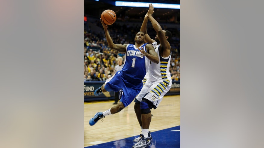 Seton Hall's Aaron Cosby (1) shoots past Marquette's Davante Gardner during the second half of an NCAA college basketball game Wednesday, Jan. 16, 2013, in Milwaukee. (AP Photo/Morry Gash)