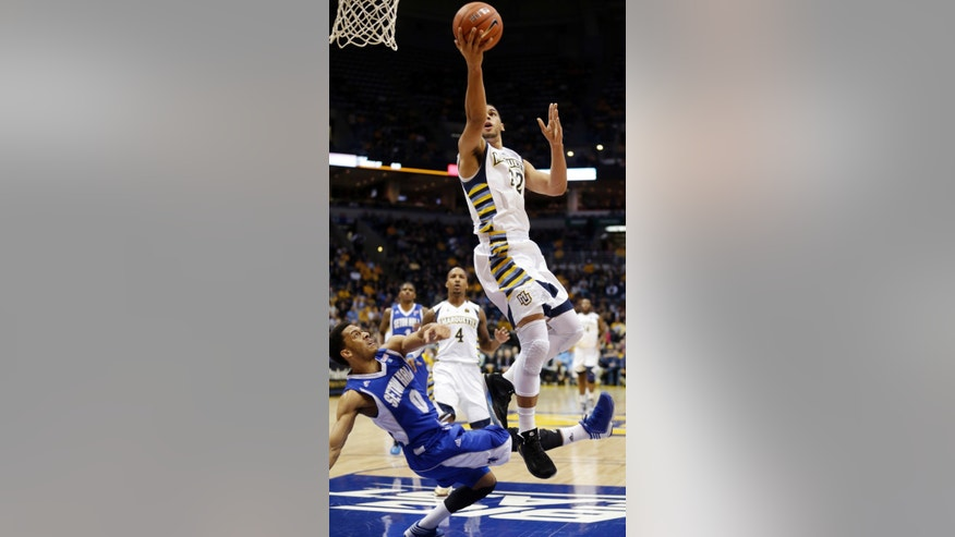 Marquette's Trent Lockett (22) is fouled by Seton Hall's Tom Maayan (0) as he shoots during the first half of an NCAA college basketball game, Wednesday, Jan. 16, 2013, in Milwaukee. (AP Photo/Morry Gash)