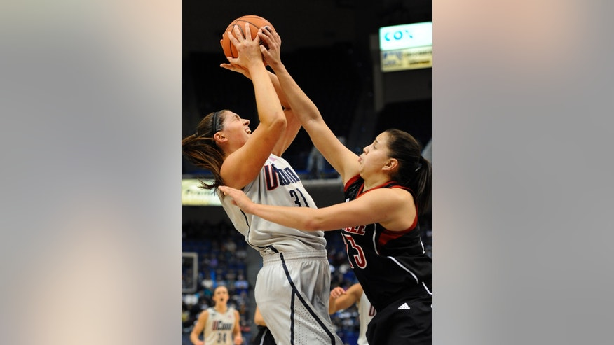 Connecticut's Stefanie Dolson, left, is pressured by Louisville's Shoni Schimmel, during the first half of an NCAA college basketball game in Hartford, Conn., Tuesday, Jan. 15, 2013. (AP Photo/Jessica Hill)