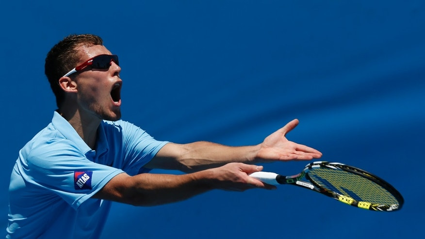 Poland's Jerzy Janowicz  reacts to a line call during his second round match against India's Somdev Devvarman at the Australian Open tennis championship in Melbourne, Australia, Wednesday, Jan. 16, 2013. (AP Photo/Andy Wong)