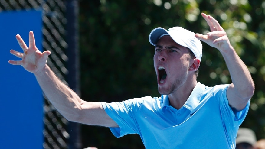 Poland's Jerzy Janowicz celebrates after his second round win over India's Somdev Devvarman at the Australian Open tennis championship in Melbourne, Australia, Wednesday, Jan. 16, 2013. (AP Photo/Andy Wong)