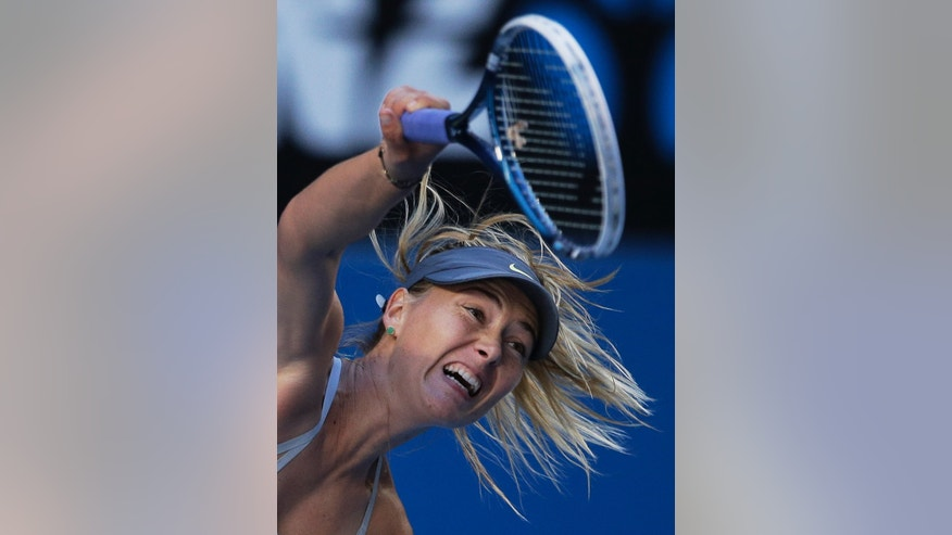 Russia's Maria Sharapova serves to Japan's Misaki Doi during their second round match at the Australian Open tennis championship in Melbourne, Australia, Wednesday, Jan. 16, 2013. (AP Photo/Rob Griffith)