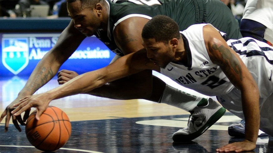 Michigan State's Derrick Nix (25) and Penn State's D.J Newbill (2) reach for a loose ball during the first half of an NCAA college basketball game in State College, Pa., Wednesday, Jan. 16, 2013. (AP Photo/Ralph Wilson)
