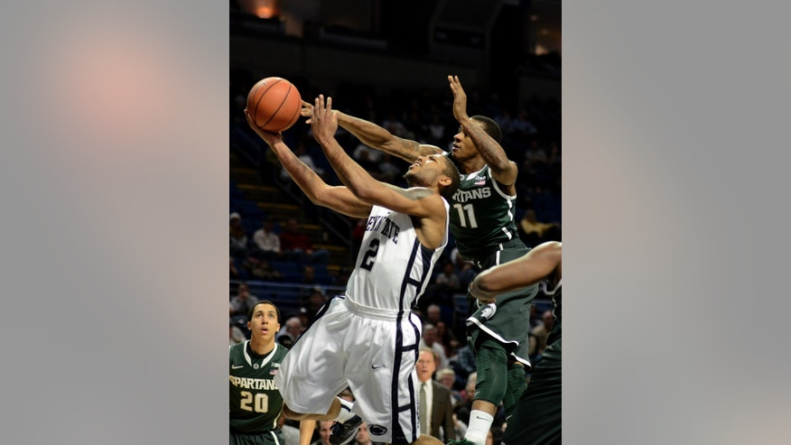 Penn State's D.J Newbill (2) shoots around a block by Michigan State's Keith Appling (11) during the first half of an NCAA college basketball game in State College, Pa., Wednesday, Jan. 16, 2013. (AP Photo/Ralph Wilson)