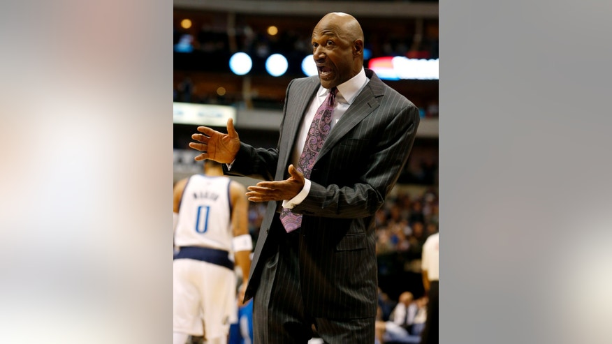 Minnesota Timberwolves assistant coach Terry Porter questions a call during the first half of an NBA basketball game against the Dallas Mavericks, Monday, Jan. 14, 2013, in Dallas. (AP Photo/Sharon Ellman)