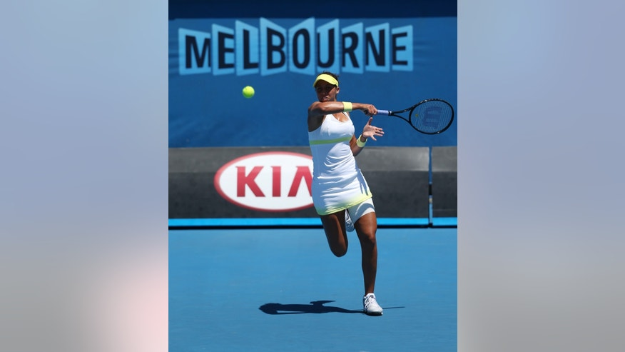Madison Keys of the US hits a forehand return to Austria's Tamira Paszek during their second round match at the Australian Open tennis championship in Melbourne, Australia, Wednesday, Jan. 16, 2013. (AP Photo/Aaron Favila)