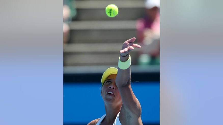 Madison Keys of the US serves to Austria's Tamira Paszek during their second round match at the Australian Open tennis championship in Melbourne, Australia, Wednesday, Jan. 16, 2013. (AP Photo/Aaron Favila)