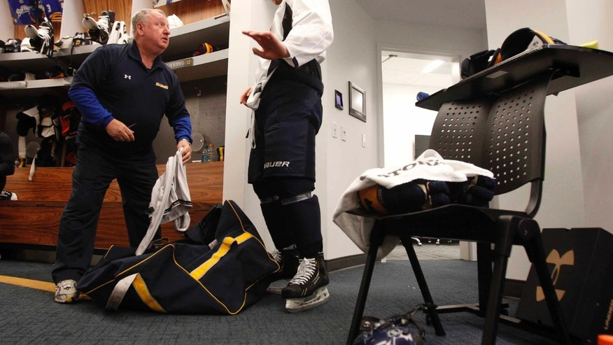 In this Jan. 13, 2013 photo, Buffalo Sabres first-round draft pick Mikhail Grigorenko, right, talks with equipment manager Rip Simonich following the Sabres, first team practice, at the First Niagara Center in Buffalo, N.Y.  Where every other Sabres player has been assigned a stall in the locker room for training camp this week, the 18-year-old rookie center is relegated to an armless chair and a TV stand in the corner, an obvious reminder that the Sabres aren't yet ready to award him a spot on their season-opening roster. (AP Photo/The Buffalo News, Harry Scull Jr.) TV OUT; MAGS OUT; MANDATORY CREDIT; BATAVIA DAILY NEWS OUT; DUNKIRK OBSERVER OUT; JAMESTOWN POST-JOURNAL OUT; LOCKPORT UNION-SUN JOURNAL OUT; NIAGARA GAZETTE OUT; OLEAN TIMES-HERALD OUT; SALAMANCA PRESS OUT; TONAWANDA NEWS OUT  (