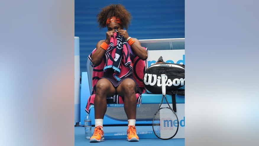 Serena Williams of the US waits in her chair during her second round match against Spain's Garbine Muguruza at the Australian Open tennis championship in Melbourne, Australia, Thursday, Jan. 17, 2013. (AP Photo/Andrew Brownbill)