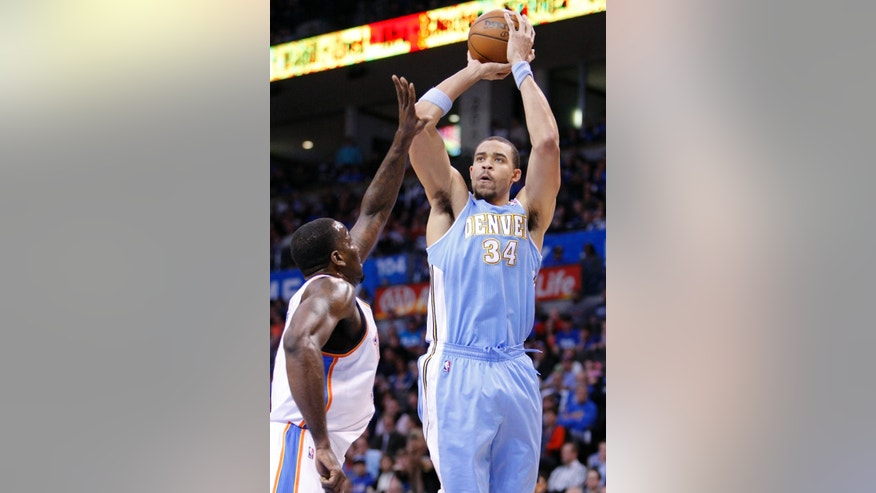 Denver Nuggets Center JaVale McGee (34) shoots against Oklahoma City Thunder center Kendrick Perkins (5) during the first quarter of an NBA basketball game in Oklahoma City, Wednesday, Jan. 16, 2013.  (AP Photo/Alonzo Adams)