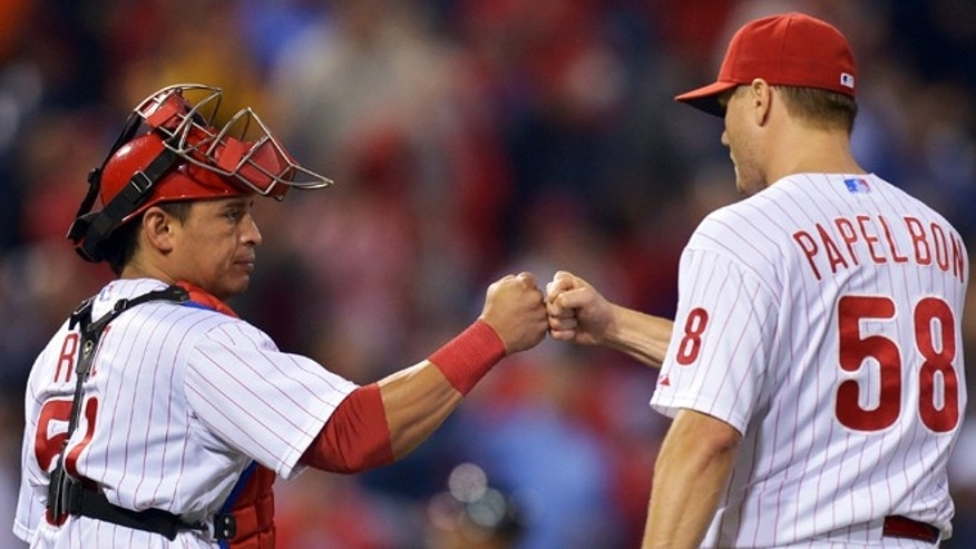 PHILADELPHIA, PA - SEPTEMBER 25: Carlos Ruiz #51 of the Philadelphia Phillies congratulates Jonathan Papelbon #58 after beating the Washington Nationals 6-3 at Citizens Bank Park on September 25, 2012 in Philadelphia, Pennsylvania. (Photo by Drew Hallowell/Getty Images)