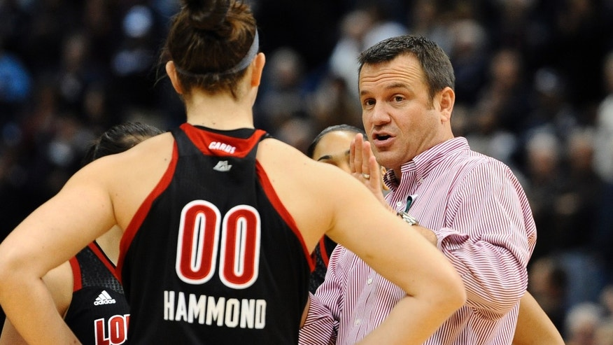 Louisville head coach Jeff Walz, right, speaks with Louisville's Sara Hammond (00) prior to tip-off of an NCAA college basketball game against Connecticut  in Hartford, Conn., Tuesday, Jan. 15, 2013. (AP Photo/Jessica Hill)