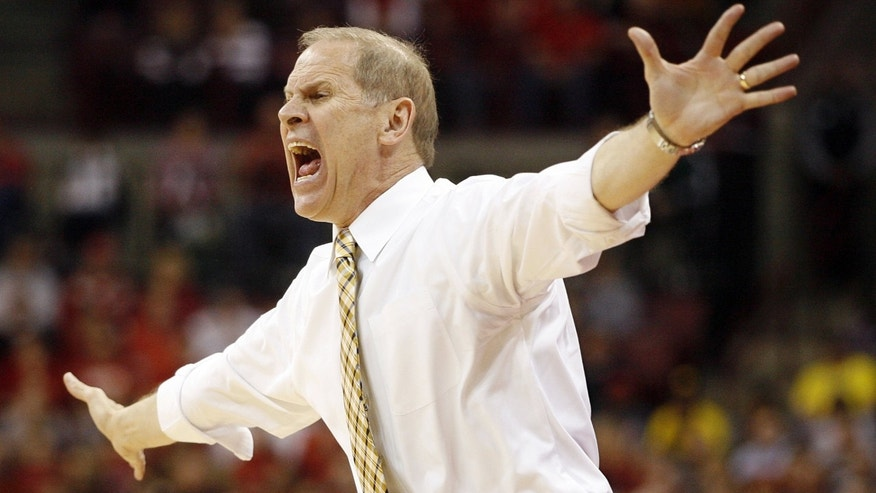 Michigan head coach John Beilein  tries to get his defense under control against Ohio State during the first half of an NCAA college basketball game Sunday, Jan. 13, 2013 in Columbus, Ohio. Ohio State won 56-53. (AP Photo/Mike Munden)