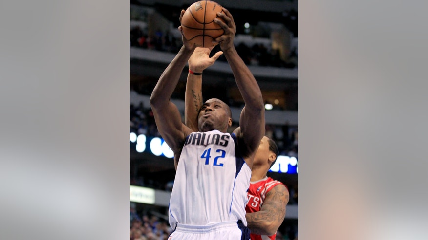 Dallas Mavericks forward Elton Brand (42) shoots as he is hit by Houston Rockets forward Marcus Morris, rear, during the fourth quarter of an NBA basketball game, Wednesday, Jan. 16, 2013, in Dallas. The Mavericks won 105-100. (AP Photo/John F. Rhodes)