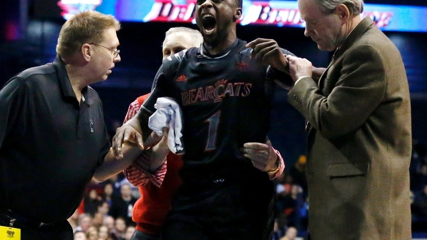 Cincinnati guard Cashmere Wright (1) reacts as he is helped to his feet and off the court during the second half of an NCAA college basketball game against DePaul, Tuesday, Jan. 15, 2013 in Rosemont, Ill. Wright went down with an apparent right knee injury with 15:12 remaining. Cincinnati won 75-70. (AP Photo/Charles Rex Arbogast)