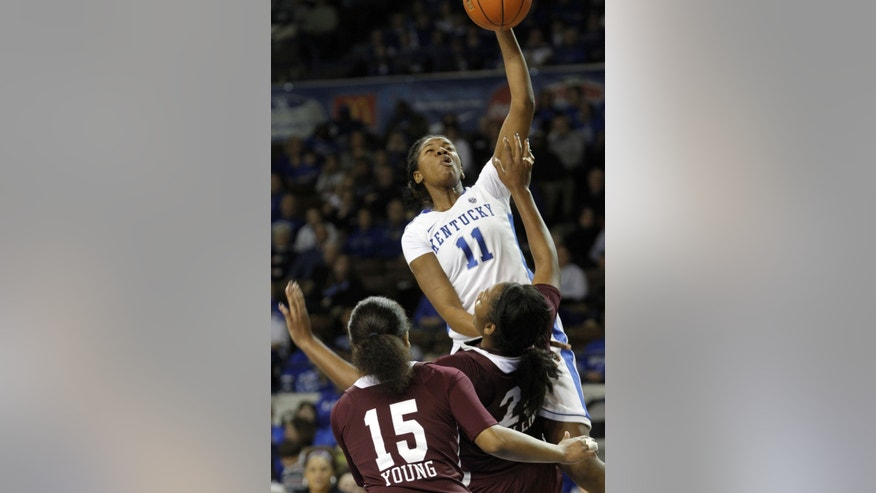 Kentucky's DeNesha Stallworth (11) shoots over Mississippi State's Carnecia Williams and Brittany Young (15) during the second half of an NCAA college basketball game at Memorial Coliseum in Lexington, Ky., Thursday, Jan. 17, 2013. Kentucky defeated Mississippi State 100-47. (AP Photo/James Crisp)