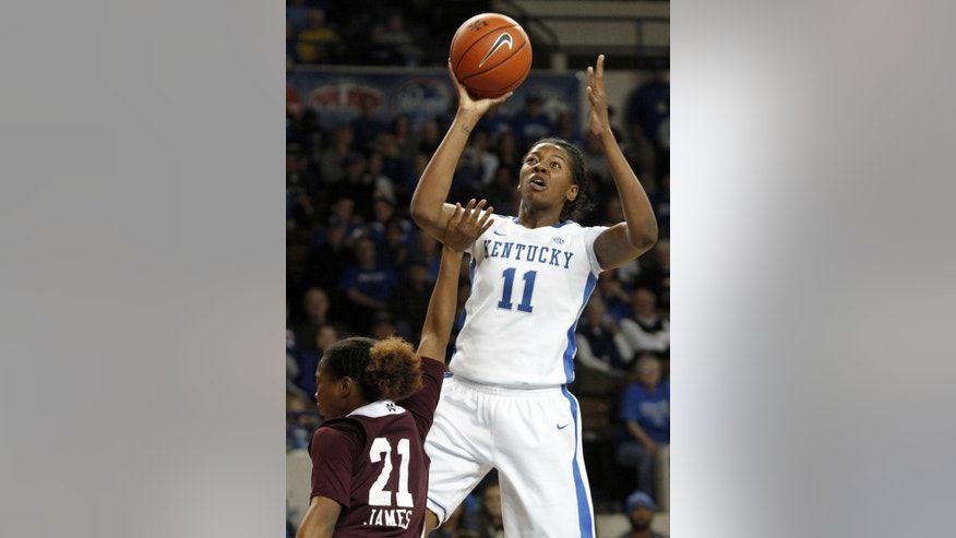Kentucky's DeNesha Stallworth (11) shoots over Mississippi State's Jerica James during the first half of an NCAA college basketball game at Memorial Coliseum in Lexington, Ky., Thursday, Jan. 17, 2013. (AP Photo/James Crisp)