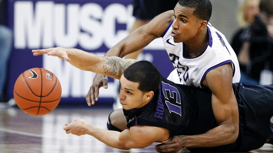Kansas State guard Angel Rodriguez (13) and TCU senior guard Nate Butler Lind battle for control of a loose ball during the first half an NCAA college basketball game on Wednesday, Jan. 16, 2013, in Fort Worth, Texas. (AP Photo/Brandon Wade)
