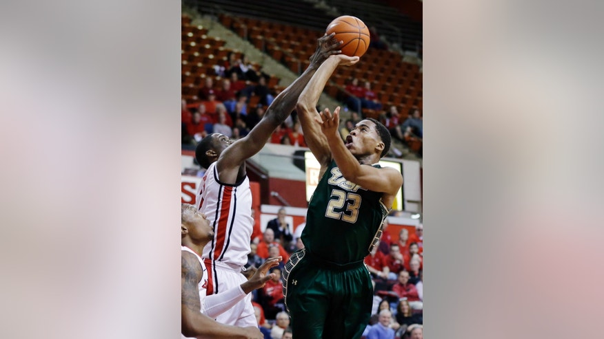 Rutgers' Dane Miller, left, blocks a shot by South Florida's Javontae Hawkins (23) during the first half of an NCAA college basketball game, Thursday, Jan. 17, 2013, in Piscataway, N.J. (AP Photo/Mel Evans)