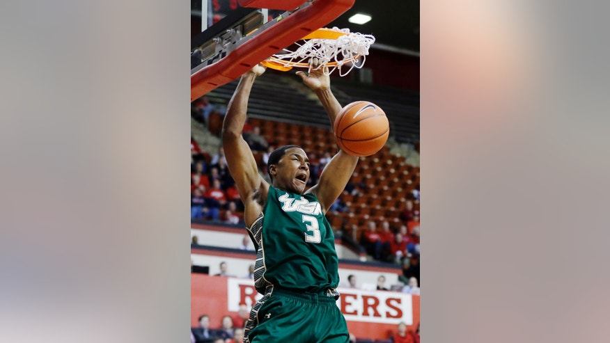 South Florida's Zach LeDay (3) dunks during the first half of an NCAA college basketball game against Rutgers, Thursday, Jan. 17, 2013, in Piscataway, N.J. (AP Photo/Mel Evans)