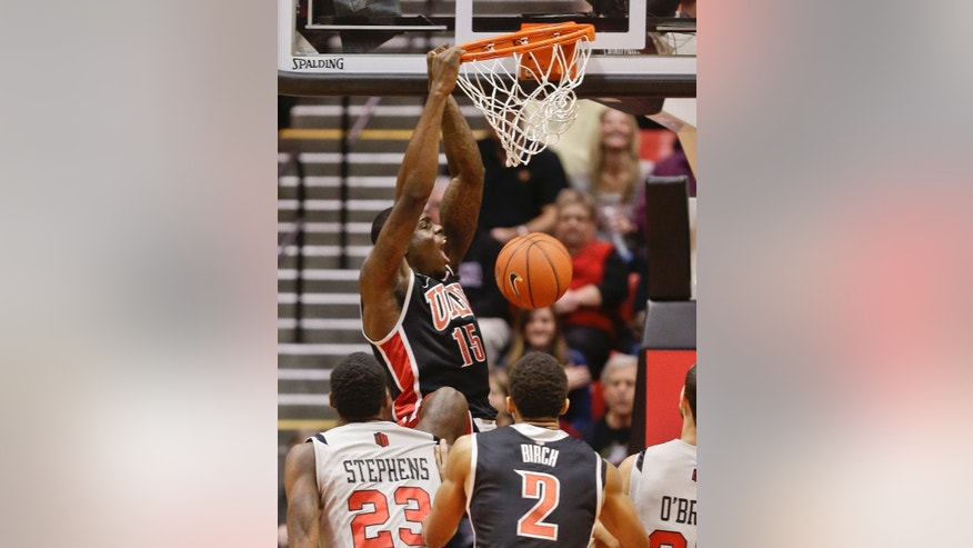 UNLV forward Anthony Bennett (15) slams home a basket against San Diego State during the first half of an NCAA college basketball game on Wednesday Jan. 16, 2013 in San Diego. (AP Photo/Lenny Ignelzi)