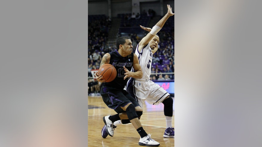 Kansas State guard Angel Rodriguez (13) drives against TCU sophomore guard Kyan Anderson (5) during the first half of an NCAA college basketball game on Wednesday, Jan. 16, 2013, in Fort Worth, Texas. (AP Photo/Brandon Wade)