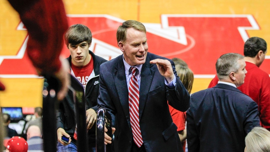 In this Jan. 16, 2013 photo,  Nebraska Athletic Director Shawn Eichorst mingles with fans at the Devaney Sports Center in Lincoln, Neb., where Nebraska played Purdue in an NCAA college basketball game. Eichorst said in an interview with The Associated Press that he admires how Nebraska football coach Bo Pelini runs the Cornhuskers' program and that he's confident Pelini will win championships. (AP Photo/Nati Harnik)
