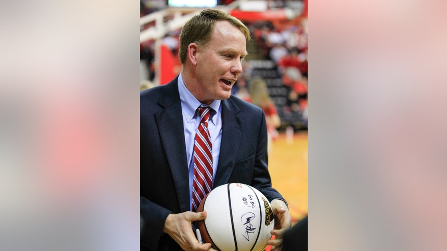 In this Jan. 16, 2013 photo, Nebraska Athletic Director Shawn Eichorst holds a basketball at the Devaney Sports Center in Lincoln, Neb., where Nebraska played Purdue in an NCAA college basketball game . Eichorst said in an interview with The Associated Press that he admires how Nebraska football coach Bo Pelini runs the Cornhuskers' program and that he's confident Pelini will win championships. (AP Photo/Nati Harnik)