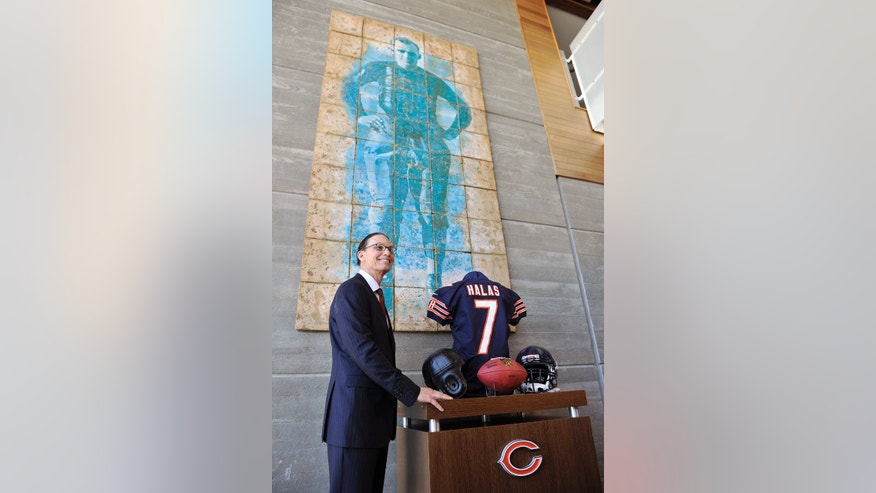 Chicago Bears NFL football team new head coach Marc Trestman  poses in the lobby of Halas Hall after being introduced during a press conference, Thursday, Jan. 17, 2013, in Lake Forest, Ill. (AP Photo/Jim Prisching)