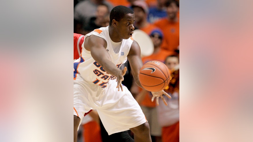 Boise State's Thomas Bropleh (15) passes the ball against New Mexico during the first half of an NCAA college basketball game, Wednesday, Jan. 16, 2013, in Boise, Idaho. (AP Photo/Matt Cilley)