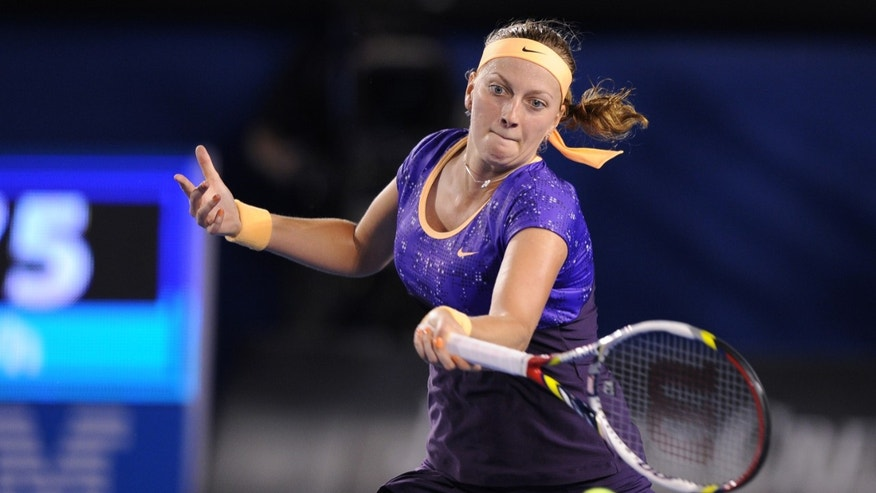 Petra Kvitova of the Czech Republic hits a forehand return to Britain's Laura Robson during their second round match at the Australian Open tennis championship in Melbourne, Australia, Thursday, Jan. 17, 2013. (AP Photo/Andrew Brownbill)