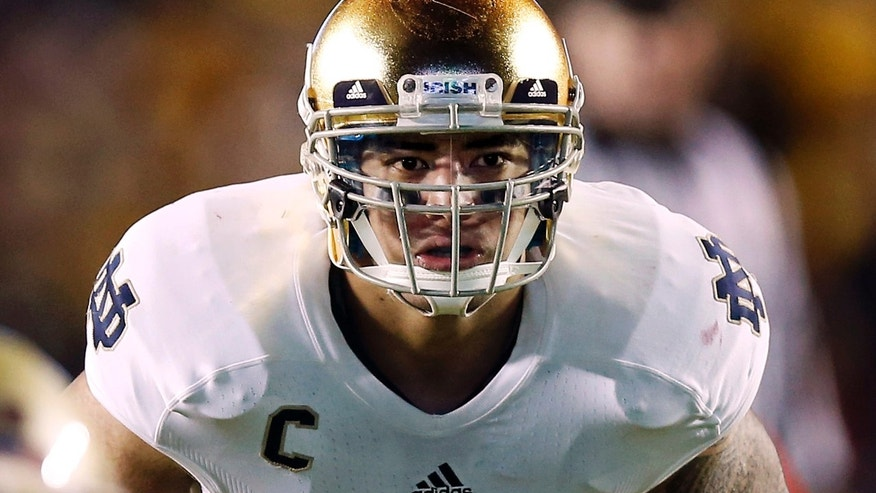 FILE - In this Nov. 10, 2012, file photo, Notre Dame linebacker Manti Te'o waits for the snap during the second half of their NCAA college football game against Boston College in Boston. A story that Te'o's girlfriend had died of leukemia _ a loss he said inspired him to help lead the Irish to the BCS championship game _ was dismissed by the university Wednesday, Jan. 16, 2013, as a hoax perpetrated against the linebacker. (AP Photo/Winslow Townson, File)