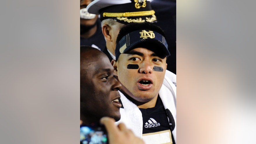 In this Nov. 17, 2012, photo, Notre Dame linebacker Manti Te'o sings the alma mater following their NCAA college football game against Stanford in South Bend, Ind. A story that Te'o's girlfriend had died of leukemia _ a loss he said inspired him to help lead the Irish to the BCS championship game _ was dismissed by the university Wednesday, Jan. 16, 2013, as a hoax perpetrated against the linebacker. (AP Photo/Joe Raymond)