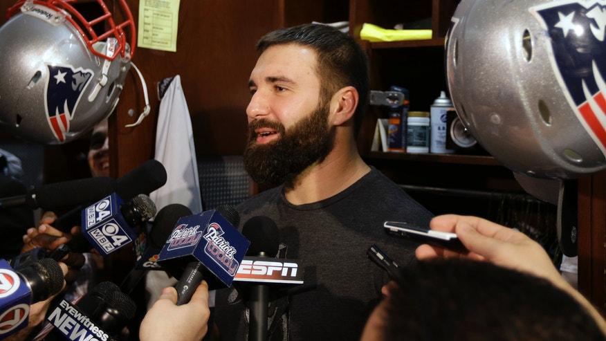 New England Patriots defensive lineman Rob Ninkovich speaks with reporters in the NFL football team's locker room at Gillette Stadium in Foxborough, Mass., Monday, Jan. 14, 2013. The Patriots are scheduled to host the Baltimore Ravens in the AFC championship game Sunday. (AP Photo/Steven Senne)