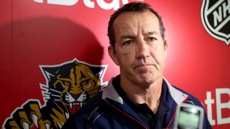Florida Panthers coach Kevin Dineen speaks to reporters during the first day of the team's NHL hockey training camp in Coral Springs, Fla. Sunday, Jan. 13, 2013. (AP Photo/J Pat Carter)