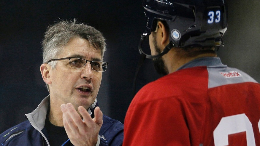 Winnipeg Jets head coach Claude Noel talks to Dustin Byfuglien (33) during NHL hockey training camp in Winnipeg, Manitoba on Tuesday, Jan. 15, 2013. (AP Photo/The Canadian Press, John Woods)