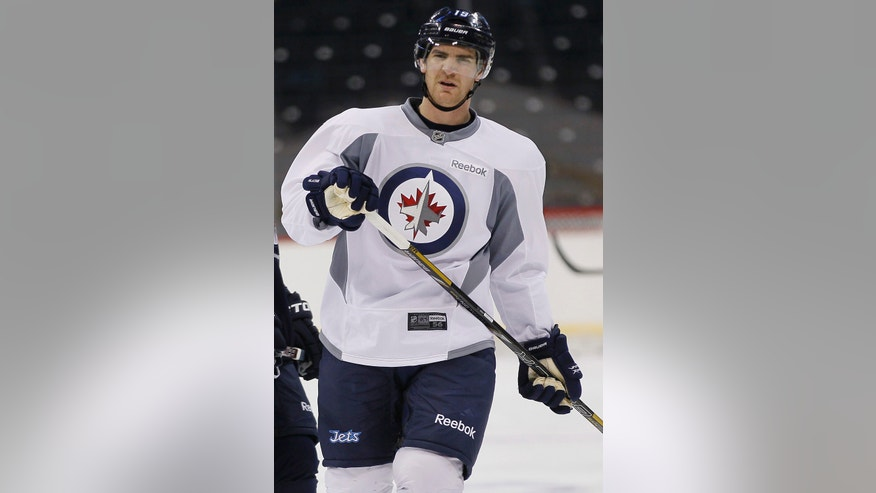 Winnipeg Jets' Jim Slater (19) does his warm up skate during their NHL hockey training camp in Winnipeg, Manitoba, on Monday, Jan. 14, 2013. (AP Photo/The Canadian Press, John Woods)