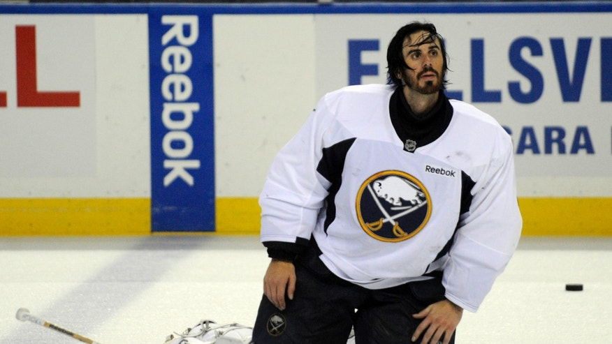 Buffalo Sabres' goalie Ryan Miller looks up after the first day of the NHL hockey training camp practice in Buffalo, New York on Sunday, Jan. 13, 2013. (AP Photo/Gary Wiepert)